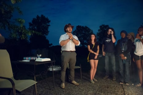 Abdul El-Sayed of Detroit talks to campaign volunteers during a cookout in Ann Arbor, Mich.