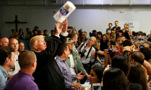 U.S. President Trump tosses rolls of paper towels to people at a hurricane relief distribution center at Calvary Chapel in San JuanU.S. President Donald Trump tosses rolls of paper towels to people at a hurricane relief distribution center at Calvary Chapel in San Juan, Puerto Rico, October 3, 2017. REUTERS/Jonathan Ernst