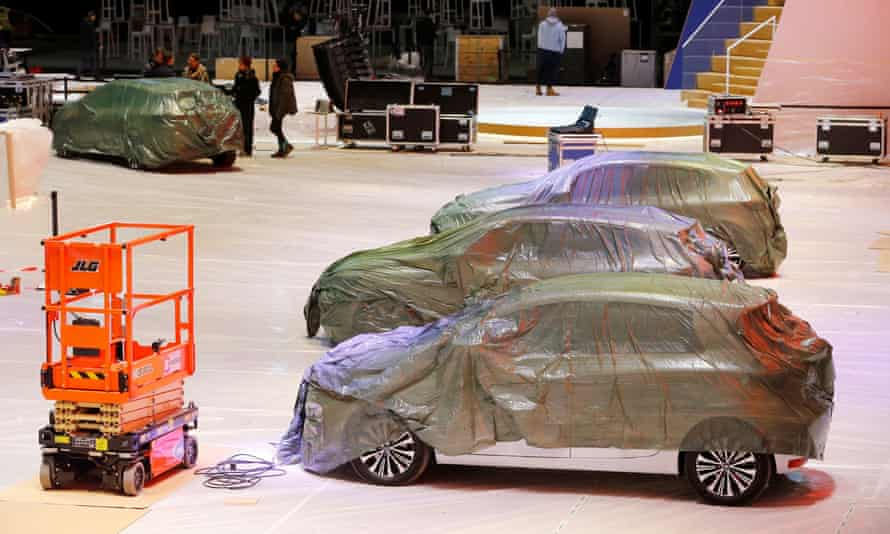 Covered cars are pictured at the Palexpo exhibition centre, which had been due to stage the Geneva motor show.