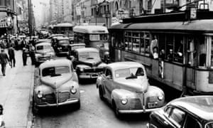 Vehicles stuck in an LA traffic jam. The city's Pacific Electric streetcar network made its final journey in 1961.