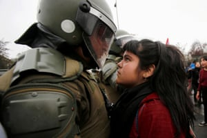 A demonstrator looks at a riot policeman during a protest marking the country's 1973 military coup in Santiago, Chile September 11, 2016. REUTERS/Carlos Vera TPX IMAGES OF THE DAY - RTSNGFH