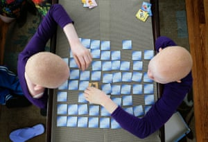 Pendo (left) and Kabula play a game of memory cards in New York.