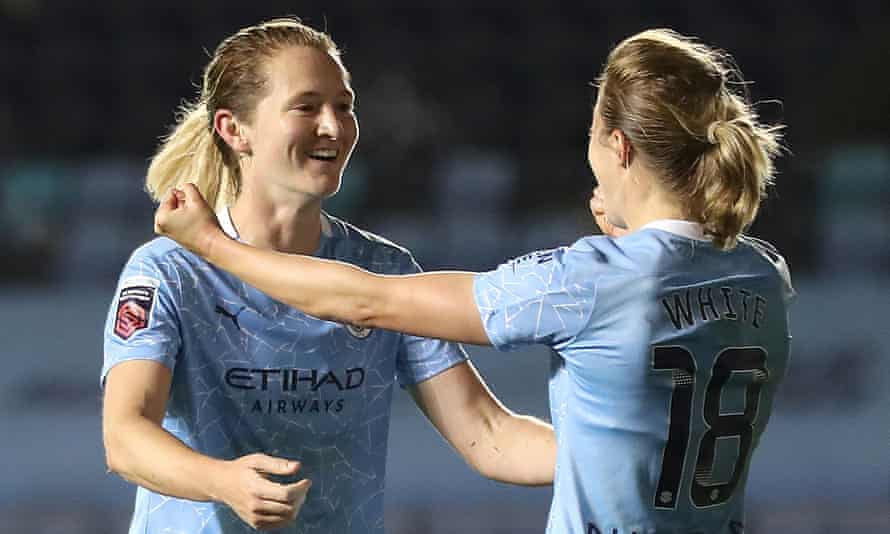 Sam Mewis celebrates with Ellen White after scoring for Manchester City against Arsenal in their FA Cup semi-final
