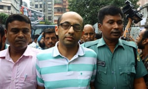 Bangladeshi police officers escort Hasnat Karim, centre, to a court appearance in Dhaka in August 2016.