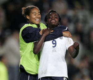 Eniola Aluko and Rachel Yankey of England celebrate qualifying for the World Cup after the match between France and England on 30 September 2006.