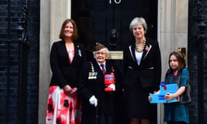 (left to right) Claire Rowcliffe, Royal British Legion Director of Fundraising, WWII veteran Barbara Weatherill, 93, Prime Minister Theresa May and fundraiser Poppy Railton, 9, outside 10 Downing Street, London as the Prime Minister makes a donation to the Royal British Legion's Poppy Appeal and receives her poppy.