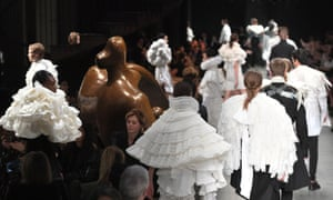 Models on the catwalk by a Henry Moore sculpture during the Burberry London fashion week show.