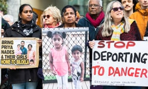 Supporters of the Tamil family seeking asylum in Australia holding placards in support outside the federal court in Melbourne on 4 September  2019