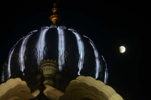 The not so red moon beside the Golden temple in Amritsar.