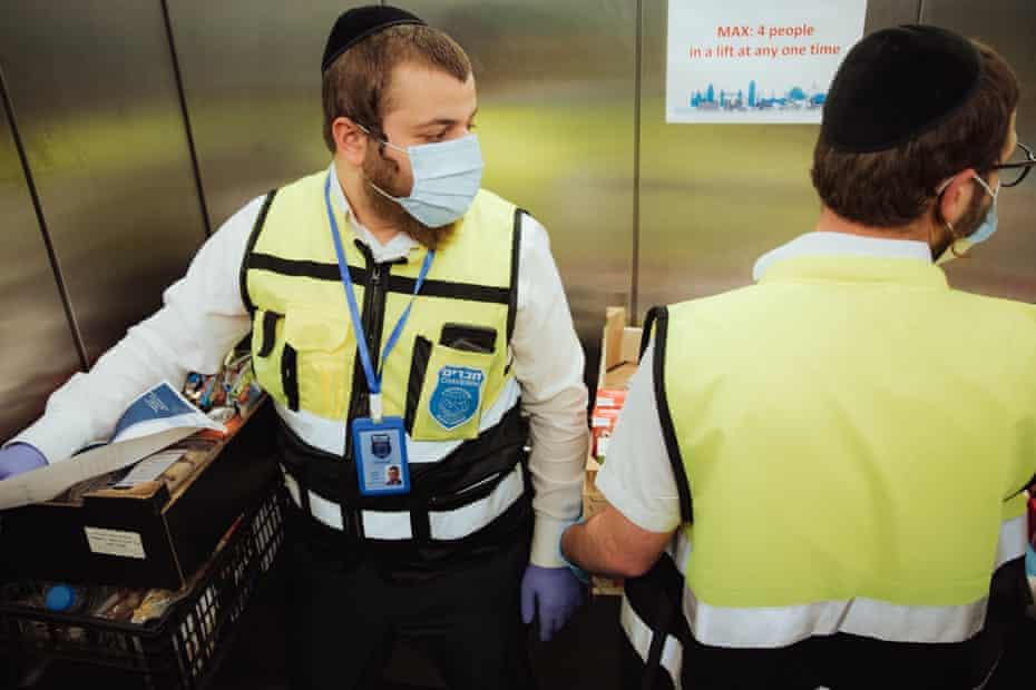 Chaveirim volunteers Yoni Koppel and Yanky Lieberman in a lift at Royal London hospital