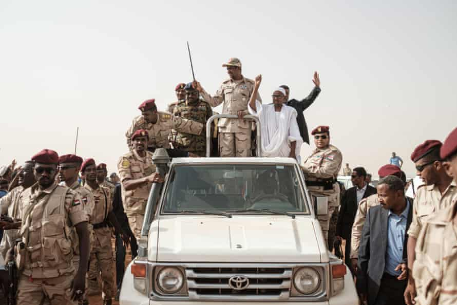 Mohamed Hamdan Dagalo waves a baton as he arrives for a rally in the village of Abraq, about 60km north-west of Khartoum