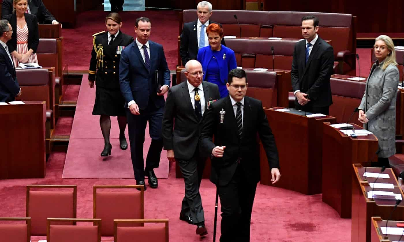 'Stop Adani': protester disrupts opening of parliament – as it happened