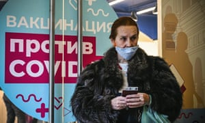 A woman waits to receive an injection of Russia's Sputnik V (Gam-COVID-Vac) vaccine at the GUM department store in Moscow.