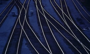 Railroad tracks, in train yard, dusk