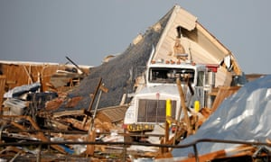 A mobile home lies on its side after a trailer park was destroyed by a tornado in El Reno, Oklahoma, on 26 May.