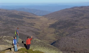 Ossie Cruse, Bobby Maher and BJ Cruse from Eden Local Aboriginal Land Council overlook the Bundian Way where it leaves the high country.