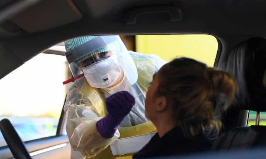 An A&E nurse demonstrating coronavirus precautions in Antrim Area Hospital, Northern Ireland.