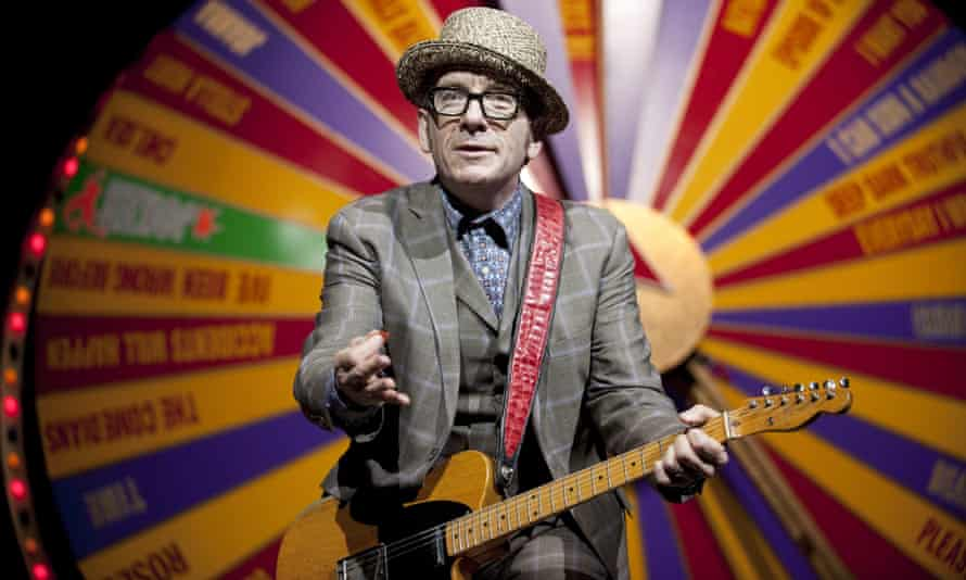 Costello during his 'revolver' tour in 2012, with the 'spectacular spinning songbook' behind him.