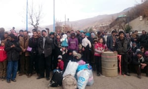 Syrians in the besieged town of Madaya waiting for the arrival of an aid convoy in January.