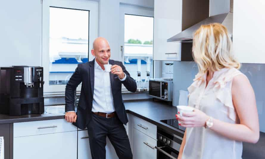 Man and woman in office kitchen