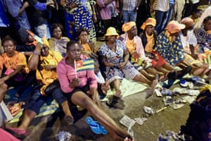Anti-government protesters sit on a street in Lomé as they keep an all-night vigil to press for constitutional reform