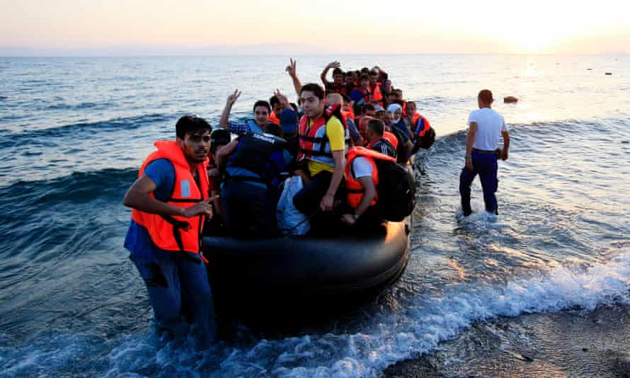 Middle Eastern refugees land in Greece.