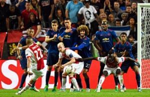 Ajax's Hakim Ziyech takes a free kick.