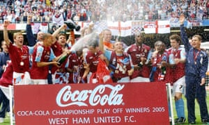 Teddy Sheringham, Bobby Zamora and their soaked West Ham team-mates drink in their play-offs success in 2005.