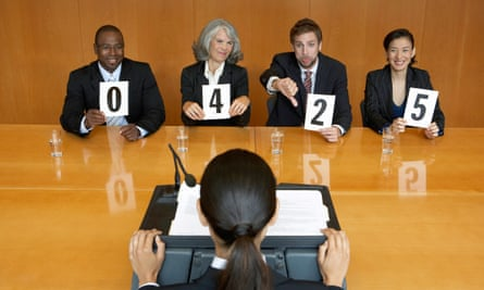 Businesswoman interview holding score cards jeering