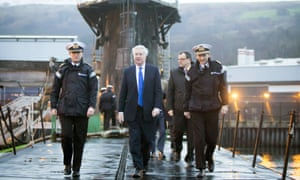 Michael Fallon, centre, aboard HMS Vigilant during a visit to the Royal Navy's submarine base at Faslane.