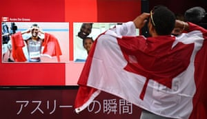 """Gold medallist in the 200m, Andre De Grasse of Canada, speaks to supporters on the """"athlete moment"""" screen."""
