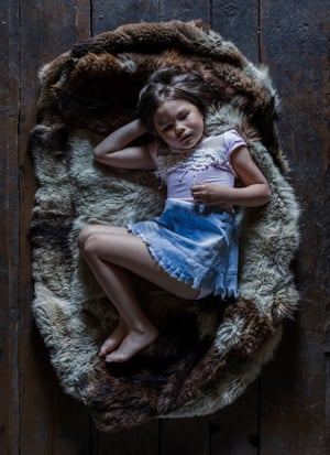 Five-year-old Irishka lies on a hunting coat