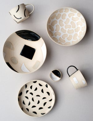 Cream and black and white ceramic cups and bowls