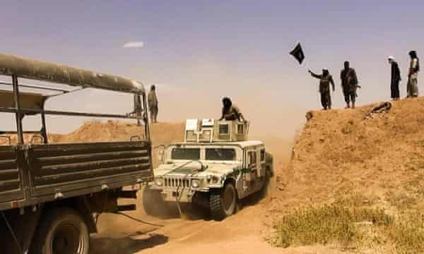 File image allegedly shows Islamic State militants on the road to Hasakah in June 2014.