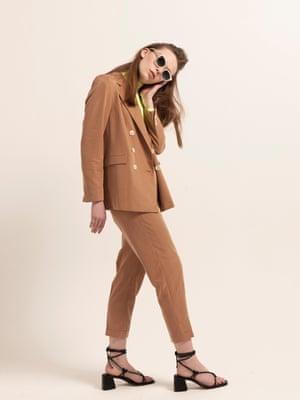 model wears bodysuit, £12.99, bershka.com. Blazer, £69.99, and trousers, £35.99, both mango.com. Shoes, £149, whistles.com. Sunglasses, £195, westward leaning.com. Suitcase, £445, awaytravel.com.