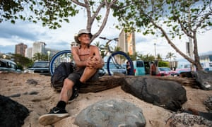 Aguirre Dick prepares to ride his bicycle to Diamond Head crater, where he now sleeps after strict laws forced him off the streets.