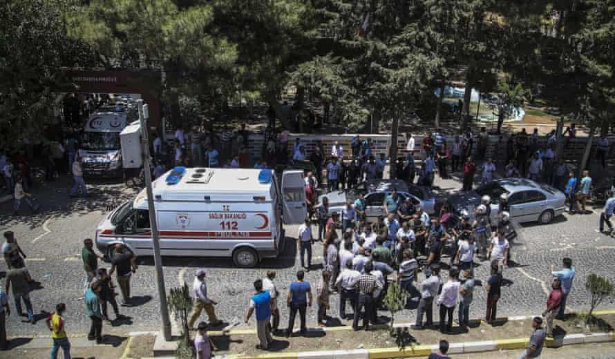 Ambulances picking up the wounded in the aftermath of the explosion.
