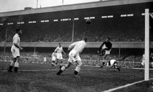 Manchester City's goalkeeper Frank Swift clears the danger during a match at Highbury in  October 1937