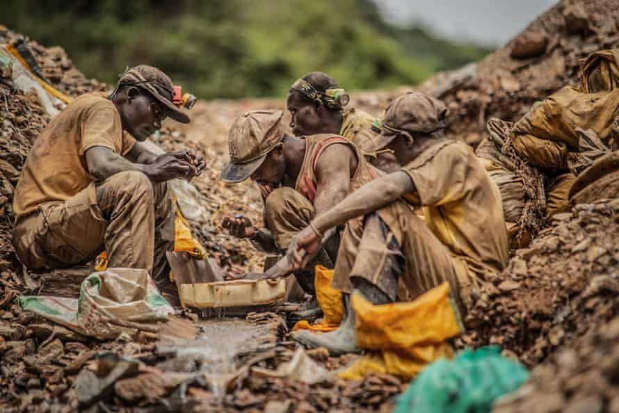 Artisanal miners pan for gold at a mine in Kamituga.