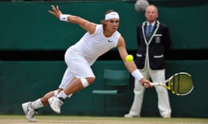 Rafael Nadal stretches to make a shot.