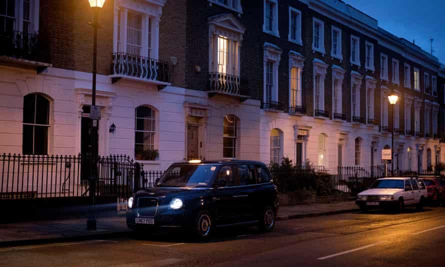 An electric black cab, on an Islington Street