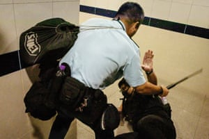 A police man beats a protester in the mens toilet inside Hong Kong International Airport on September 1, 2019