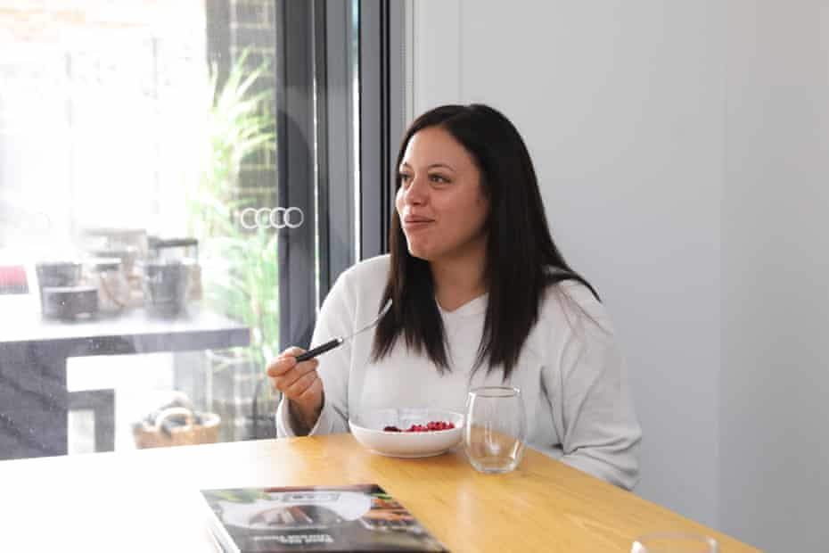 Lainie Saiz samples salad prepared in a Thermomix