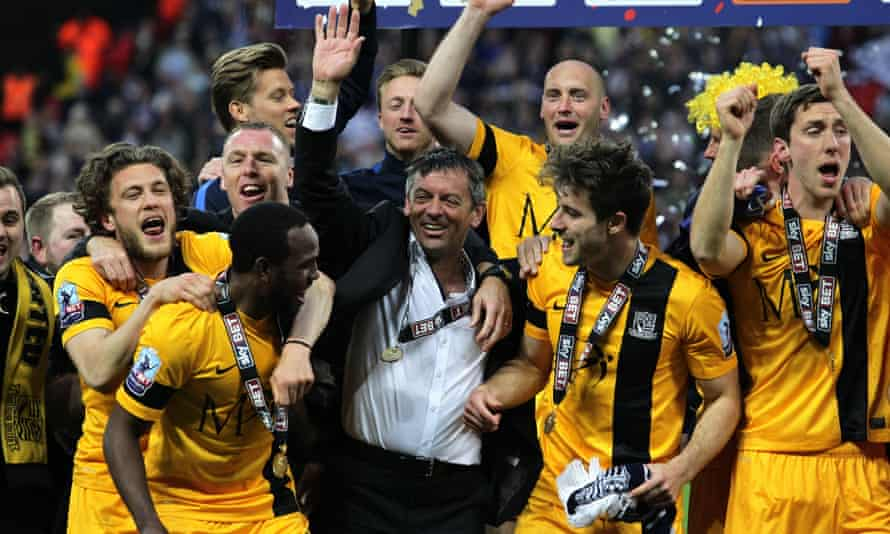 Phil Brown celebrates with Southend's players after winning the 2015 League Two play-off final.