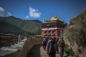 Ethnic Tibetan pilgrims walk on the grounds of the Labrang Monastery in Xiahe, an ethnically-Tibetan town in Gansu province, China