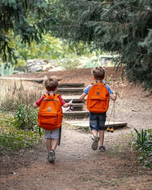 Kids with backpacks at Cambridge University Botanic Garden