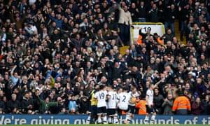 White Hart Lane erupts as Toby Alderweireld celebrates with team-mates.