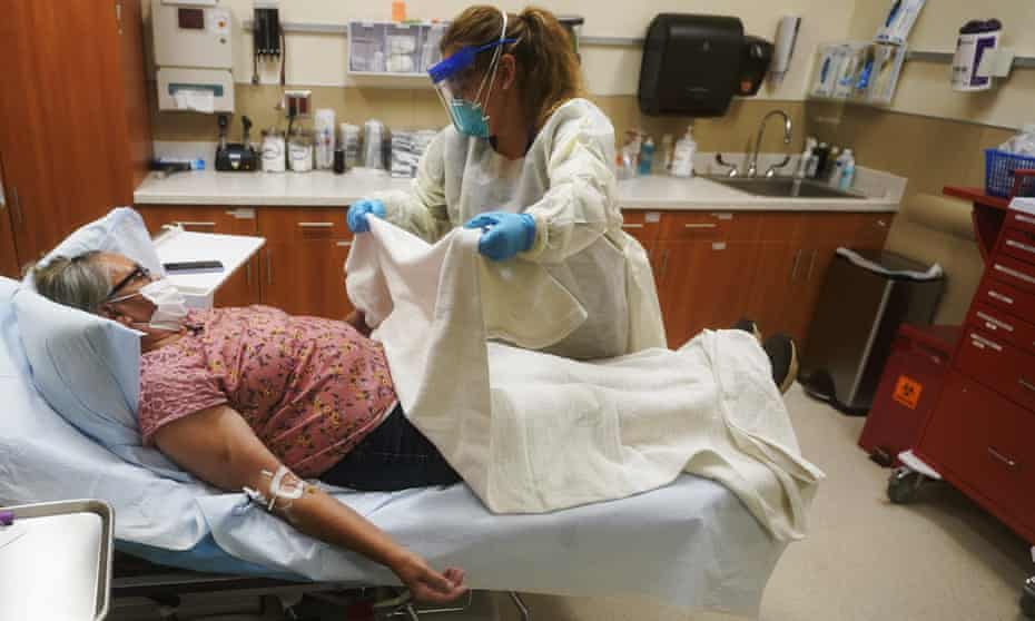 Angie Cleary, a registered nurse, cares for a Covid patient in Tok, Alaska.