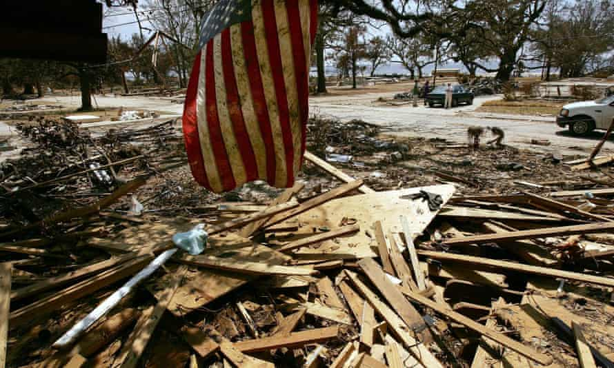 A US flag hangs from the roof of a home destroyed by Hurricane Katrina in Mississippi in 2005.