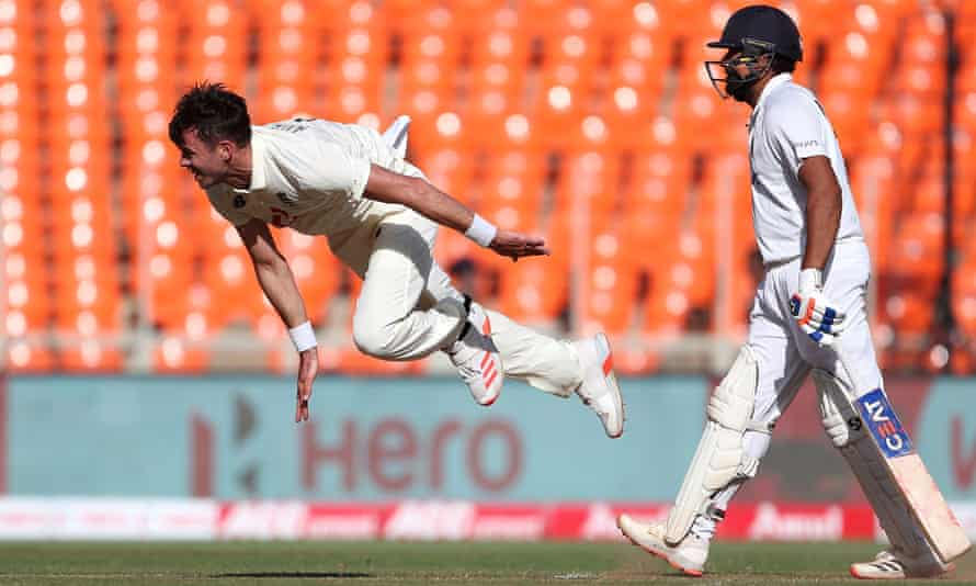 Jimmy Anderson of England bowls as India's Rohit Sharma backs-up during day one of the fourth Test.